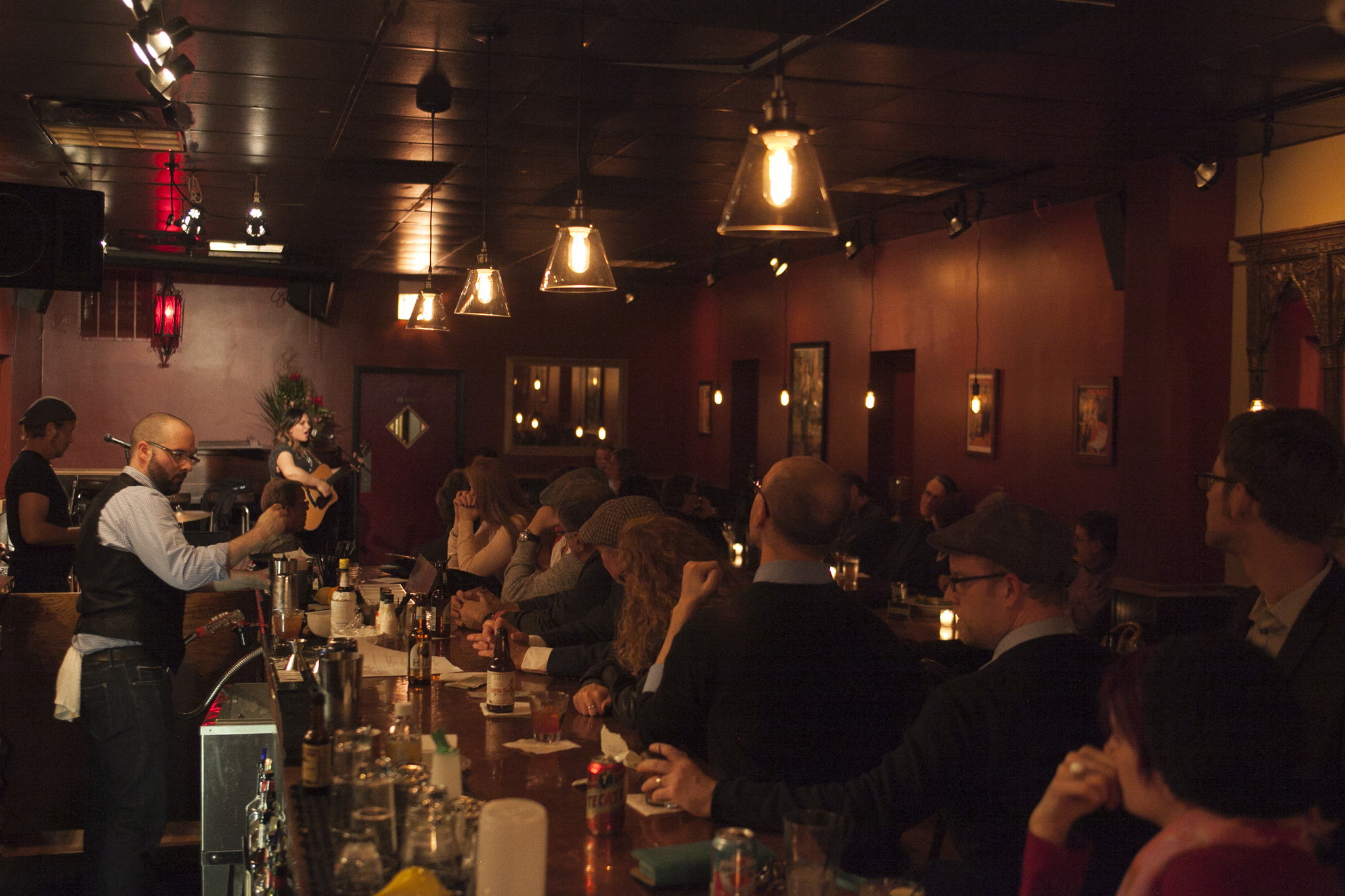 Patrons watch from the bar as Abbi Rajasekhar (cq) performs at High Hat Club's grand opening, Oct. 4, 2014.  (Kristan Lieb/For the Chicago Tribune)
